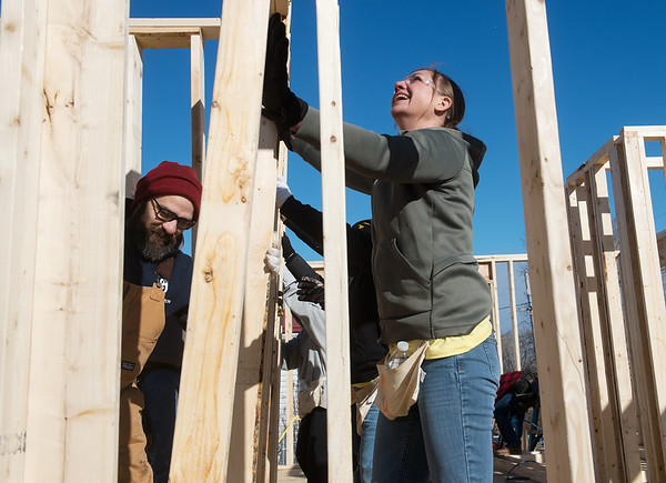 Jeff Youngblood and Becky Rouse, workers at General Mills, help raise a wall on Monday for a Habitat for Humanity build in Joplin.<br /> Globe | Roger Nomer