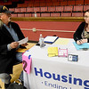 U.S.  Marine Corps veteran Dan Pierson, left,  discusses housing information with Economic Security Housing Resource Coordinator Shonna Greninger during the Homeless Connect event on Thursday at Memorial Hall. The event, sponsored by The Homeless Coalition of Jasper and Newton County, featured a variety of services including resources for healthcare, education, housing and more.<br /> Globe | Laurie SIsk