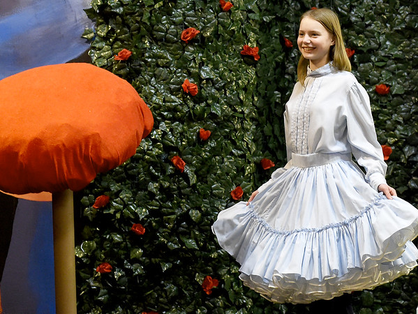 """Grace Dalrymple portrays """"Alice"""" during rehearsal for the Stained Glass Theatre production of """"Alice in Wonderland"""" on Thursday night at the theatre.<br /> Globe   Laurie Sisk"""