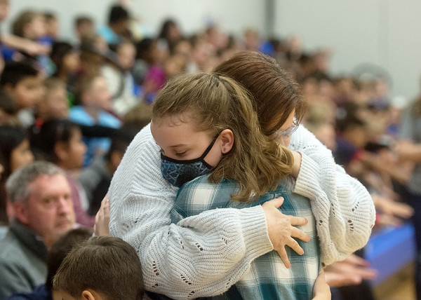 Paige Talbot, fifth grade, gets a hug from her grandmother Donna Ipolck after learning about her Make-A-Wish trip to Hawaii on Friday at the Carthage Intermediate Center.<br /> Globe | Roger Nomer
