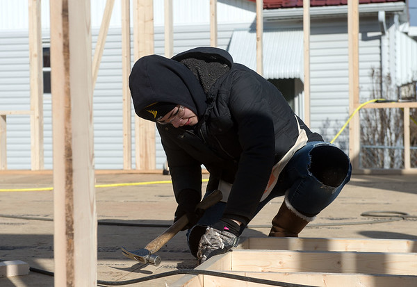 Leilani McGinnis, a worker with General Mills, helps assemble a wall while volunteering on a Habitat for Humanity build on Monday in Joplin.<br /> Globe | Roger Nomer
