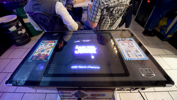 A vintage version of a Donkey Kong Junior tabletop game is one of numerous arcade games at Flicker.<br /> Globe | Laurie SIsk