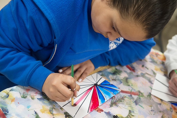 Joselyne Perez, fifth grader at St. Mary's Elementary, paints a Valentine for a veteran on Friday at the school.<br /> Globe | Roger Nomer