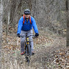 Mountain bike enthusiast Jeff Chance takes a ride in a wooded area of Morse Park on Saturday.<br /> Globe | Laurie SIsk