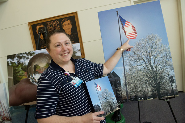 Venetta Banwart, occupational therapist assistant at Freeman Hospital, points out a cross-shaped refraction in a flag in her photo on Wednesday at Freeman Hospital.<br /> Globe | Roger Nomer