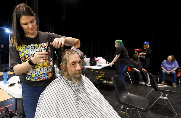 Stylist Misha Honey, of The Ritz salon, gives Donald Seats a fresh haircut during the Homeless Connect event on Thursday at Memorial Hall. The event, sponsored by The Homeless Coalition of Jasper and Newton County, featured a variety of services including resources for healthcare, education, housing and more.<br /> Globe | Laurie SIsk