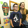 Proud Harry S. Truman teacher Whitney Nobis stands beside her Oronogo pupil, fourth grader Lucas Mitchell, 10, whose Egyptian art was selected for the K12 Chidren's Art Show on Tuesday night at Missouri Southern's Spiva Gallery. <br /> Globe | Laurie Sisk