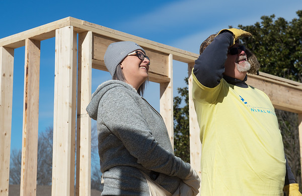Breanna Arnold talks with Dan Carver, maintenance technician with General Mills as they watch Arnold's house construction on Monday at a Habitat for Humanity build in Joplin.<br /> Globe | Roger Nomer