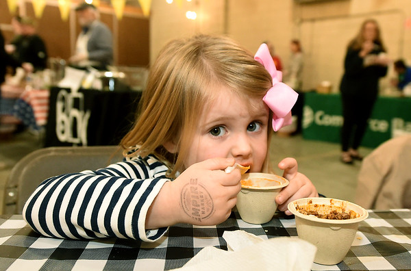 Four-year-old Ella Howerton samples bowls of chili during the 2nd Annual Empire Market Chili Cookoff on Saturday at the market. Eight different entries of chili included a bison chili, a vegan chil and a wine-based chili.<br /> Globe | Laurie Sisk