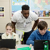Tylan Harris works with Addy Young and Andrew Esterline, fifth graders at Jefferson Elementary, on Thursday at Jefferson Elementary.<br /> Globe | Roger Nomer