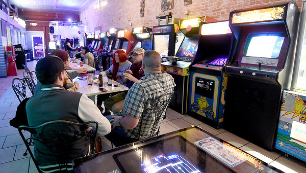 Customers take food, beverage and conversation near a large assortment of arcade games at Flicker.<br /> Globe | Laurie Sisk