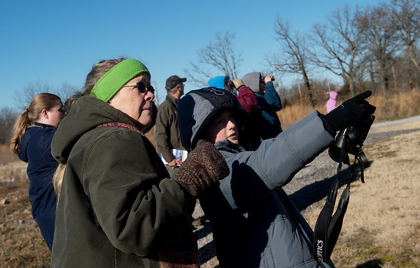 Landyn Evans-O'Neal, 12, Joplin, points out a bird to his grandmother Cyndi Cogbill during Saturday's Kids Christmas Bird Count at the Shoal Creek Conservation Education Center.<br /> Globe | Roger Nomer