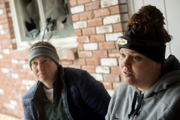 Darci Sneed (left) and Megan Stanley talk about the arson that burned their home during an interview on Thursday.<br /> Globe | Roger Nomer