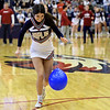 Joplin High School cheerleader Vanessa Morris tries to keep control of her balloon during the balloon relay races on the opening day of the Kaminsky Classic basketball tournament on Thursday at JHS.<br /> Globe | Laurie Sisk