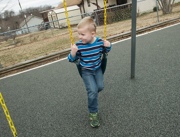 Thor Caughorn, 5, plays on the new surface at the Webb City Head Start playground on Thursday.<br /> Globe | Roger Nomer