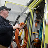 Dustin Griffberg, Carl Junction firefighter, checks equipment on Wednesday at the Carl Junction Fire Department.<br /> Globe | Roger Nomer