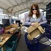 Shannon Wendy drops off items for recycling and reuse on Tuesday at the Joplin Recycking Center. <br /> Globe | Laurie Sisk