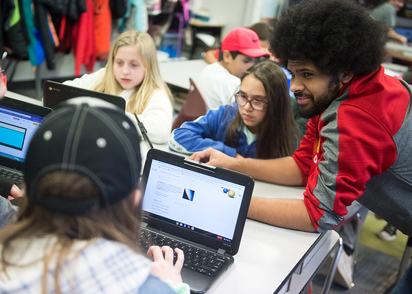Brock Compton works with his fifth-grade students on Jan. 30 at West Central Elementary.<br /> Globe | Roger Nomer