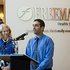Paula Baker, Freeman Health System president and chief executive officer, and Rahul Oberoi, Freeman NICU physician, talk about the new volunteer cuddling program on Tuesday at Freeman Hospital.<br /> Globe | Roger Nomer