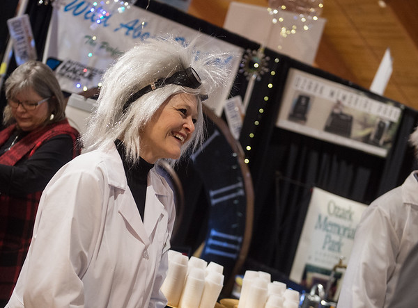 Tamara Barnett, owner of Wild About Water!, greets visitors on Tuesday at the Joplin Area Chamber of Commerce Business Expo at Downstream Casino.<br /> Globe | Roger Nomer