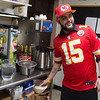 Jake Dhar prepares for his shift as a server at the Red Onion Cafe on Tuesday.<br /> Globe | Roger Nomer