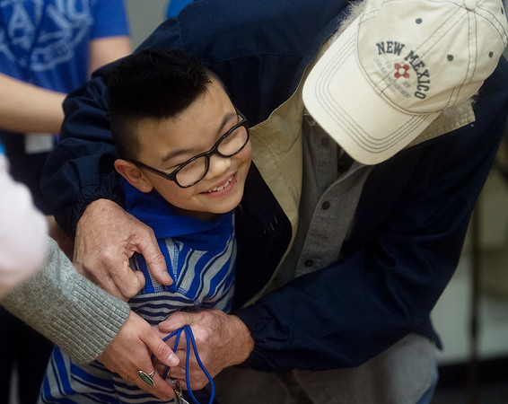 Quill Baxter gets a hug from his grandfather Paul Cline after receiving his Make-A-Wish trip on Friday at the Carthage Intermediate Center.<br /> Globe | Roger Nomer