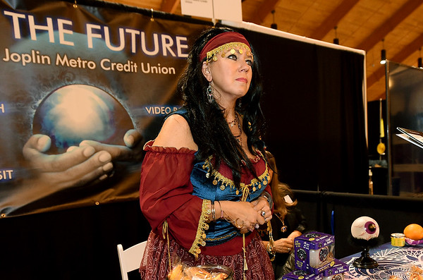 Joplin Metro Credit Union Branch Manager Laura Dobbs dresses as a fortune teller as she helps guests envision their future during the Joplin Area Chamber of Commerce's Business Expo 20/20 See the Future event on Wednesday at Downstream Casino.<br /> Globe | Laurie Sisk