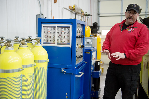 Carl Junction Fire Chief Joe Perkins talks about the department's air tank refilling station on Wednesday at the Carl Junction Fire Department.<br /> Globe | Roger Nomer