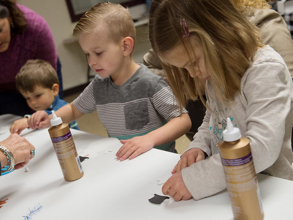 (from left) Elijah Buck, 3, Lincoln DePratt, 4, and Maara Allegra, 4, work on constructing snowmen during Wednesday's Preschool Nature Connections: Secrets of Winter event at the Joplin Empire Market. The event was held by the Wildcat Glades Friends Group.<br /> Globe | Roger Nomer
