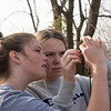 Zoe Satterlee (left) and Abby Hodson, Carl Junction seniors, bait a hook at the Carl Junction outdoor classroom on Tuesday.<br /> Globe | Roger Nomer