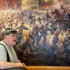 Jim Williams talks about the Andy Thomas mural at the Carthage Civil War Museum on Wednesday.<br /> Globe | Roger Nomer