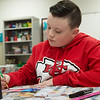 Collin Schmitt, fifth grader at St. Mary's Elementary, works on a Valentine for a veteran on Friday at the school.<br /> Globe | Roger Nomer