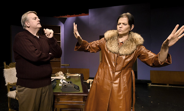 "From the left: Greg Green (as Sidney Bruhl) and Rhonda Palmer (as psychic Helga Tendorp) rehearse their roles for the upcoming Joplin Little Theatre Production of ""Deathtrap,"" which opens Jan. 29 at JLT. The Ira Levin comedy thriller is directed by Ashley Trotnic.<br /> Globe 
