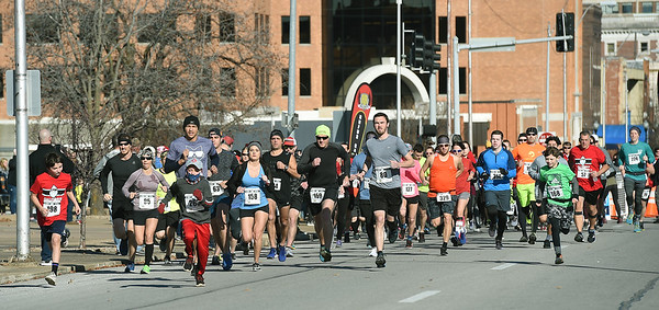 Runners make their way down Joplin Street at the start of the Chilly 5K on Wednesday at Memorial Hall.<br /> Globe | Laurie Sisk