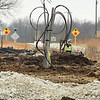 Lines of electrical cables protude from the ground on Thursday near the intersection of Hwy 43 and Hwy 126 as workers prepare for the site of a staging area for the construction of wind turbines near Liberal.<br /> Globe | Laurie Sisk