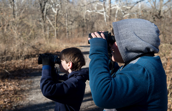 Tre Hays (left), 11, Webb City, and Preston Palmer, 11, look for birds during Saturday's Kids Christmas Bird Count at the Shoal Creek Conservation Education Center.<br /> Globe | Roger Nomer
