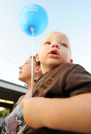 "Globe/T. Rob Brown<br /> One-year-old Gunner Heistand, looks around the fairgrounds as he carries a ""Myers for County Attorny"" balloon Wednesday evening, July 18, 2012, during the Cherokee County Fair in Columbus, Kan. Heistand is carried by his aunt Brandi Jarvis."