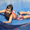 Globe/T. Rob Brown<br /> Matthew Morley, 6, of Belton, takes a head-first ride down a water slide at Ewert Park Family Aquatic Center in Joplin Saturday afternoon, July 21, 2012, during the hottest part of the day. Many families hit the local pools Saturday to difuse the heat.