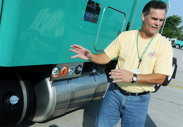 Globe/Roger Nomer<br /> Eliot Medina talks about a new fuel efficient engine on his Tri-State Motor Transit truck during an interview on Friday.