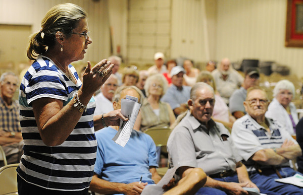 Globe/T. Rob Brown<br /> Mary Beth Yeakey, of Silver Creek, asks questions of Joplin city officials regarding snow removal Thursday evening, July 19, 2012, during a public meeting about the proposed consolidation of Silver Creek and the city of Joplin, at the Jack Lawton Webb Convention Center in Saginaw.