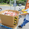 Globe/T. Rob Brown<br /> Crosslines Pantry Manager Konrad Fehrenbach, left, of Joplin, and volunteer Danny Morris, of Carthage, bring in a load of donated potatoes Friday afternoon, July 13, 2012.