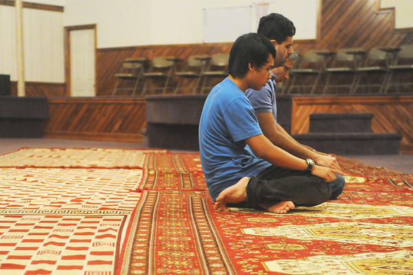 Globe/Roger Nomer<br /> (from left) Alvian Salim, Waqas Chishti and Asadullah Ahmed participate in a prayer service at the Islamic Society of Joplin's mosque on Thursday afternoon.