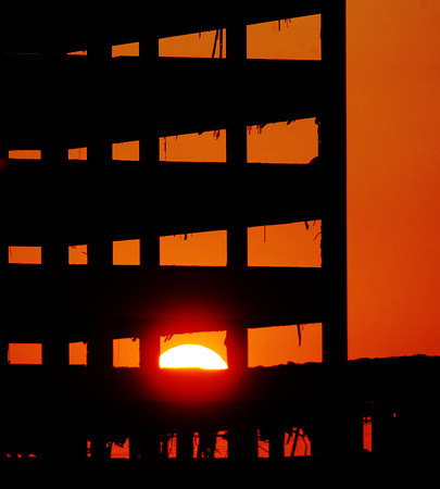 Globe/T. Rob Brown The sun sets behind what's left of Mercy-St. John's hospital Friday, July 14, 2012.