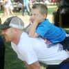 Globe/Roger Nomer<br /> David and Dalton, 4, Nading, Columbus, watch a game of Bocce at Lincoln Park during Pittsburg's Fourth of July celebration on Wednesday.
