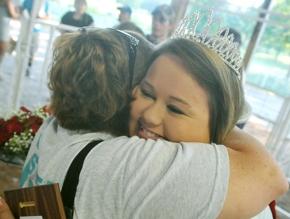 Globe/Roger Nomer<br /> Jasper County Youth Fair Queen Sarah Bass gets a hug after winning the competition on Tuesday evening.
