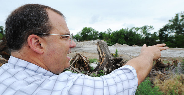 Globe/T. Rob Brown Richard Martinous, of Joplin, son of Mose and Kathy Martinous, who both live on the property, talks about the dust and other factors related to what he believes is an illegal dumping operation at Bullfrog Mine.
