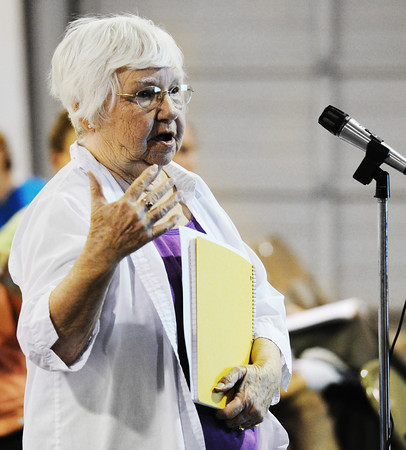 Globe/T. Rob Brown<br /> Betty Gaskin, of Silver Creek, asks questions of Joplin city officials regarding fire district tax changes Thursday evening, July 19, 2012, during a public meeting about the proposed consolidation of Silver Creek and the city of Joplin, at the Jack Lawton Webb Convention Center in Saginaw.