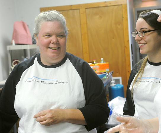 Globe/Roger Nomer<br /> Ginger Reppond talks with Edie Swafford, 16, while preparing a meal at Souls Harbor on Wednesday, July 4, 2012.