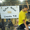 Globe/Roger Nomer<br /> Paten Neher, 10, Jasper, finds it hard to keep his eyes open during a late-night weigh in at the Jasper County Youth Fair on Tuesday.
