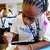 Globe/T. Rob Brown<br /> Imunique Moody-McBride, 12, of Kansas City, Mo., grinds a peanut to help make peanut milk Saturday morning, July 14, 2012, during Carver Day events at the George Washington Carver National Monument near Diamond. Peanut milk was the result of a class science experiment with peanuts, taught by volunteer Ashley Burns, in the monument's laboratory.